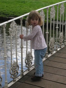 Katie playing pooh sticks
