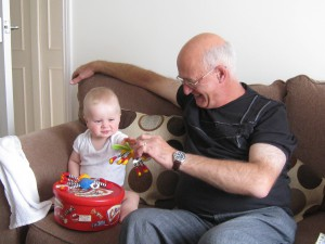 Sam playing with his Grandad