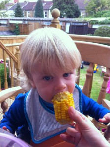 Sam ruthlessly eating a corn on the cob